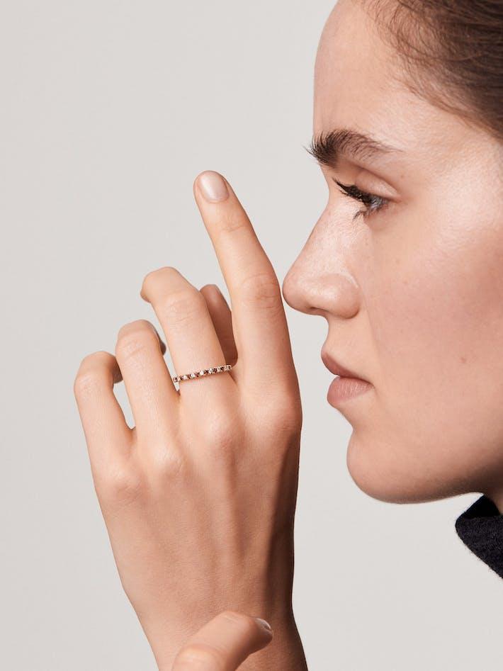 Diamond and garnet eternity ring
