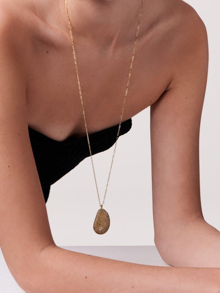 Fierce gold, stone and diamond necklace