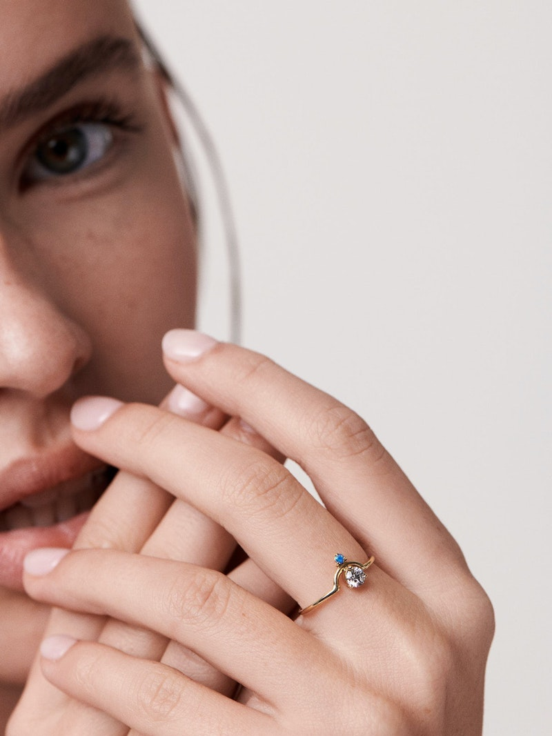 Girl wearing ring with antique diamond and opal
